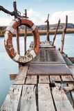 Gangway over the water and a lifebuoy Royalty Free Stock Image
