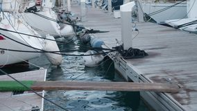 Gangway from yacht to floating jetty. Black mooring on floor. Gangway from yacht to floating jetty. Maina stock video