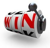 Ganhe a palavra nas rodas da máquina de entalhe - jogando Fotografia de Stock