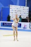 Ganna Rizatdinova with hoop. PESARO, ITALY - APRIL 28: Ganna Rizatdinova from Ukraine performs with hoop during the rhythmic gymnastic World Cup on April 28 royalty free stock photography