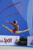 Ganna Rizatdinova with ribbon. PESARO, ITALY - APRIL 28: Ganna Rizatdinova from Ukraine performs with ribbon during the rhythmic gymnastic World Cup on April 28 royalty free stock image