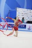 Ganna Rizatdinova with ribbon. PESARO, ITALY - APRIL 28: Ganna Rizatdinova from Ukraine performs with ribbon during the rhythmic gymnastic World Cup on April 28 stock image