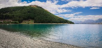 Ganska sommardag på sjön Tekapo, Nya Zeeland Fotografering för Bildbyråer