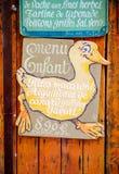 Ganso velho engraçado do vintage que mostra a crianças o menu Fotografia de Stock