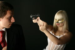 Gansta kill. Gansta girl kill man from pistol Stock Image