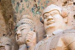 GANSU KINA - April 09 2015: Budda statyer på Tiantishan grottor Arkivfoton