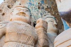 GANSU KINA - April 09 2015: Budda statyer på Tiantishan grottor Fotografering för Bildbyråer