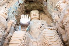 GANSU KINA - April 09 2015: Budda statyer på Tiantishan grottor Arkivfoto