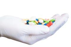 Gant avec des pilules Photographie stock