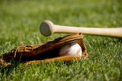 Gant, 'bat' et bille de base-ball Photographie stock