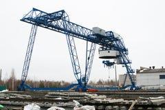 Gantry crane. Large gantry crane in between lifting Stock Image