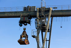 The gantry crane against  blue sky Royalty Free Stock Photo