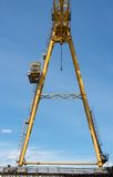 Gantry crane against the blue sky Stock Image