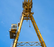 Gantry crane against the blue sky Stock Images
