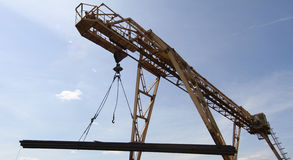 Gantry crane lifts and moves a pack with metal reinforcement Royalty Free Stock Images
