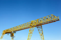 Gantry crane over blue sky Stock Images
