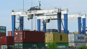 Gantry cranes load an intermodal train stock footage