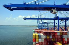 Gantry cranes are loading cargo on the container ship in port of Charleston, South Carolina. stock photography