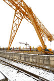 Gantry cranes over railroad in outdoor warehouse Royalty Free Stock Photography