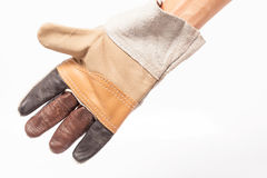Gants en cuir pour le technicien-réparateur PL in FR has S on both words sûr Sur le fond blanc photographie stock libre de droits