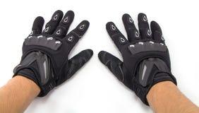 Gants noirs de moto d'isolement Images stock