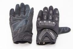 Gants noirs de moto d'isolement Photographie stock libre de droits