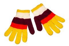 Gants tricotés par s de ` d'enfant, multicolores photos libres de droits