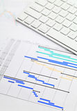 Gantt chart and keypad. At office Royalty Free Stock Image
