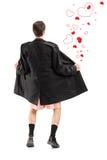 Ganzaufnahme eines Blitzgebers in einem Mantel und Herzen um h Lizenzfreies Stockbild