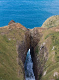A gap carved in the cliff Stock Image