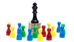 Gap between classes. Board game figures in front of white background - concept of gap between classes Stock Photos