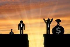 Gap entre l'homme riche et pauvre Photo stock