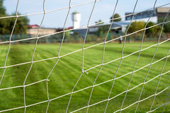Gap in football net Royalty Free Stock Image