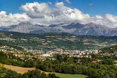 Gap, Hautes Alpes in Summer. French Alps, France. The city of Gap in the Hautes Alpes with surrounding mountains and peaks in Summer. Southern French Alps royalty free stock photo