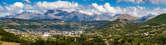 Gap, Hautes Alpes in Summer. Panoramic. French Alps, France. The city of Gap in the Hautes Alpes with surrounding mountains and peaks in Summer. Panoramic royalty free stock image