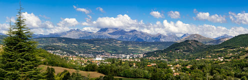 Gap, Hautes Alpes in Summer. Panoramic. French Alps, France. The city of Gap in the Hautes Alpes with surrounding mountains and peaks in Summer. Panoramic Stock Photos