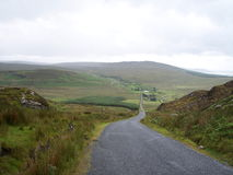 Gap of Mamore, Co. Donegal. A long road through the Gap of Mamore in Ireland Royalty Free Stock Images
