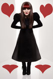 Gap queen. Dark queen of hearts looking at camera on white background Royalty Free Stock Photo
