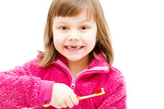 Gap toothed girl. Brushing her teeth isolated on white Stock Photos