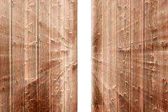 Gap in the wooden fence and the emerging light Royalty Free Stock Photos