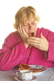 Gape. Elderly woman is gaping in the morning Stock Photo