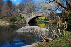 Quiet Moment at Gapstow Bridge, Central Park. Serene view of Gapstow Bridge and the Duck Pond in the fall in Central Park, New York City.  A quiet moment away Stock Photos