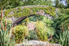 Gapstow bridge with greenery in Central Park stock photo