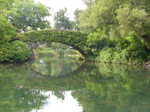 Gapstow Bridge in summer 2. Gapstow Bridge in Central Park, Located in New York City. The bridge is very green during the summer. Took a second picture Royalty Free Stock Images
