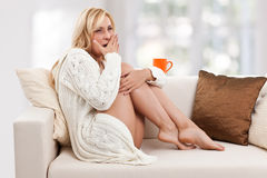 Gapy woman on the sofa Stock Image