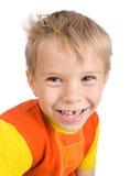 Garçon âgé de cinq ans de sourire Images stock