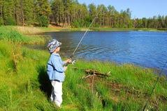 Garçon 12 de pêche Photos stock