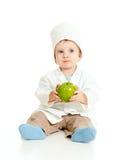 Garçon adorable en uniforme comme docteur avec la pomme verte Images libres de droits