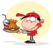 Garçon affamé regardant fixement la plaque des aliments de préparation rapide illustration stock