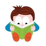 Garçon affichant un livre Photo stock